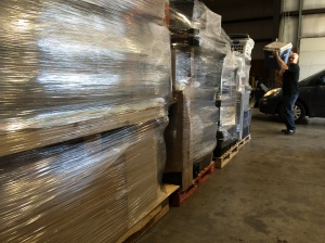 Five of the nine pallets packed for shipment