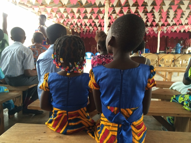 Two little girls watching the end of an adult Sunday school class in the main sanctuary