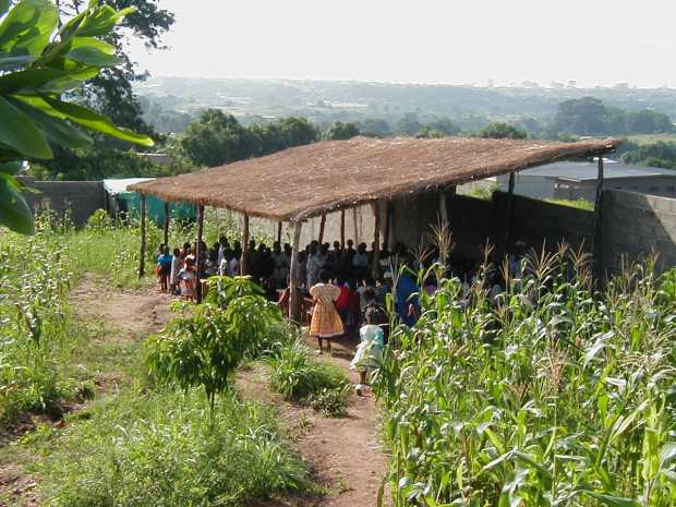 The first Sunday school shelter built was in Cote d'Ivoire in 2002. It had a thatch roof.